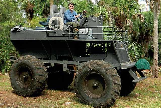 The author in Gene Van Schaick's homemade buggy, which was constructed using plate metal, steel channel and parts from military vehicles.