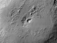 pitted terrain marcia crater Vesta