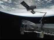Dragon Captured and Berthed to Station