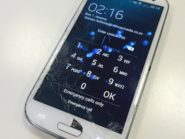 Samsung Galaxy SIII with cracked screen.