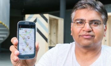 Darshan Santani with the app created for drivers in Nairobi.