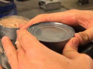 How to open a can without a can opener, knife or tools