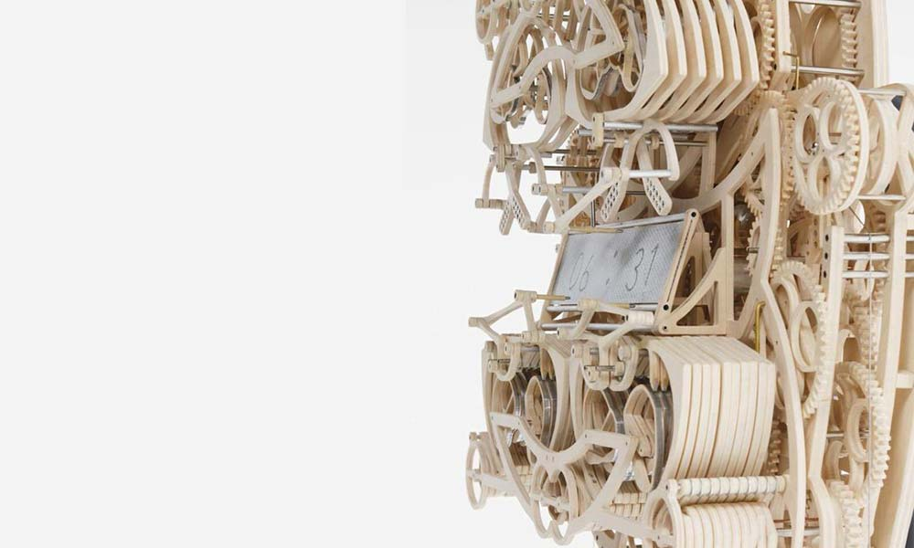 Hand-made wooden clock writes the time