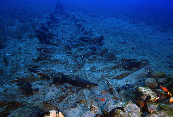 The remains of a wooden shiwpreck on the seafloor by Vasilis Mentogianis