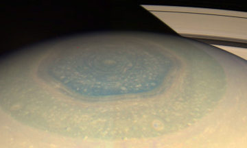 Saturn's mysterious hexagon changed colour