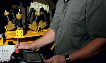 Ivan Möller controls the robot using a Human Machine Interface (HMI) under the watchful gaze of his brother, Anton.