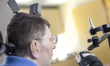 Brain implant helps paralysed man feed himself again