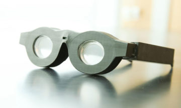 Liquid lenses that automaticall focus on whatever the wearer i looking at, far away or close up.