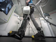 Toyota demonstrates the equipment at Tokyo headquarters. A patient practice walking wearing the robotic leg on a special treadmill that supports their weight.
