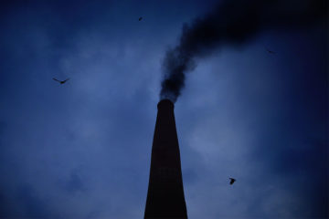 An image of a steeple with smoke to represent carbon dioxine, monoxide and methane.