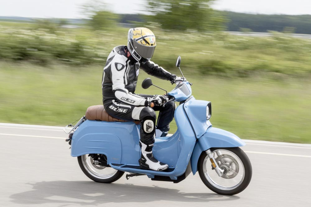 Modern motorcycles: a guy on a blue scooter