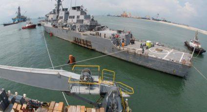 USS McCain lifted onto a ship that ships ships